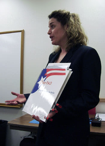 VotePAD representative Dianna Smith shows off her company's system